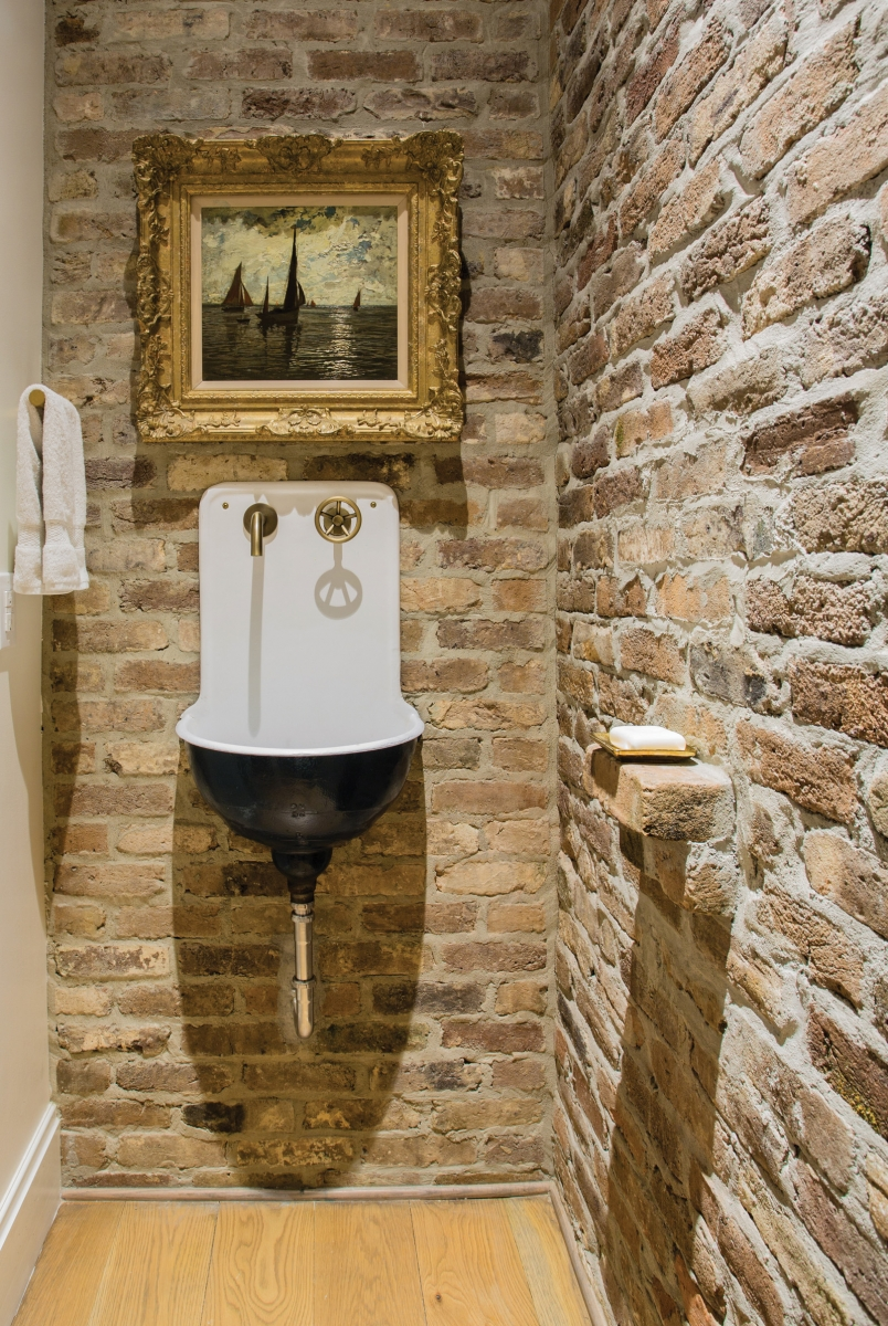 modern and traditional design_reclaimed sink and salvaged brick